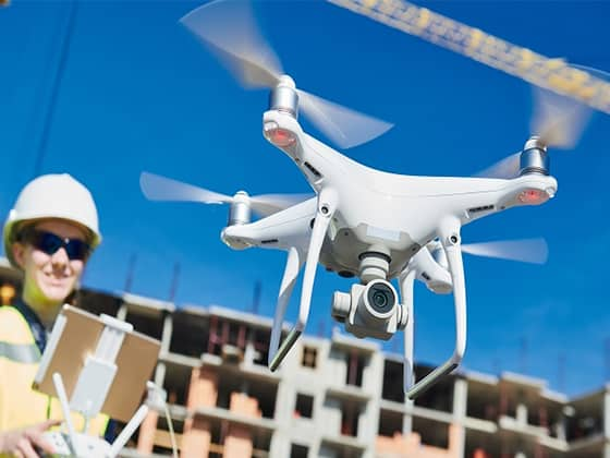 A drone flying and a woman on a building site
